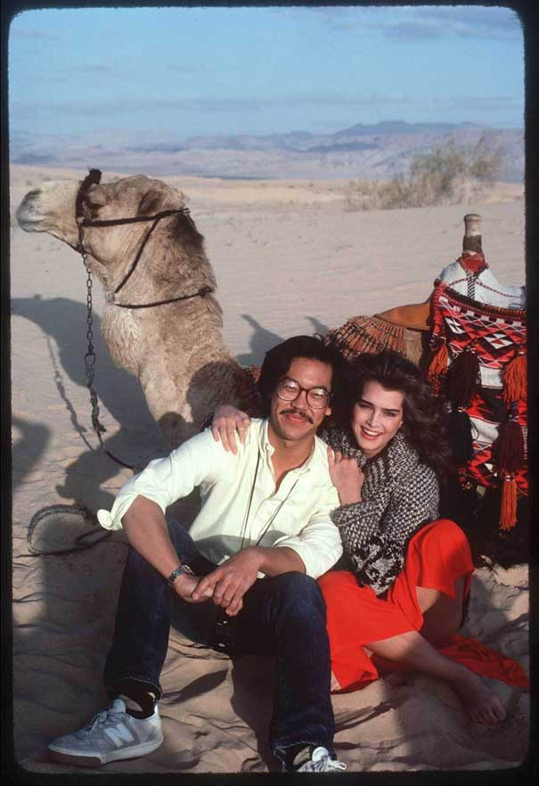 Leslie Wong with Brooke Shields on location near Eilat, Israel on the film Sahara (1983).